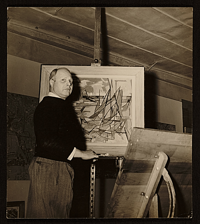 [Carl Holty with one of his paintings]
