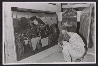 Lt. Daniel J. Kern and Karl Sieber examining the Ghent Altarpiece in the Altaussee mine
