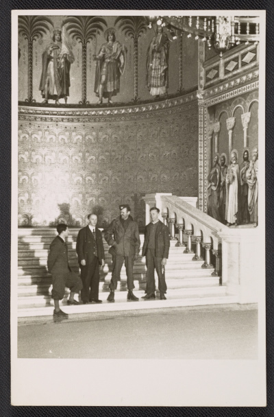 [Four men standing in the throne room of Neuschwanstein Castle in Bavaria]