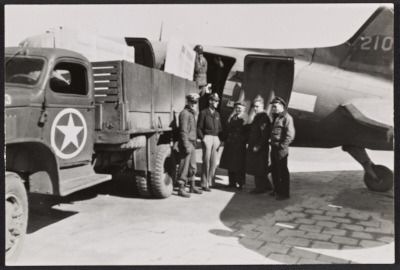 Soldiers standing by a truck and plane at Munich airport