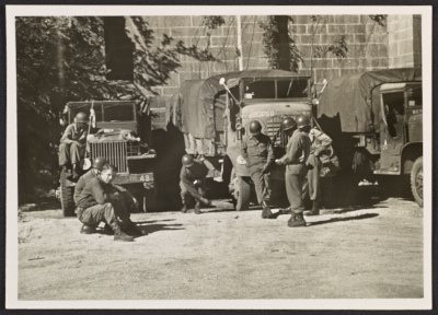 Soldiers standing in front of trucks for transporting art recovered in the salt mines at Altaussee, Austria