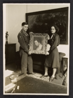 Raymond Lemaire and Edith Standen holding a Rubens portrait at Wiesbaden Collecting Point