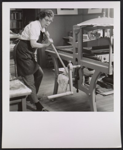 Victoria Hutson Huntley working at her lithography press