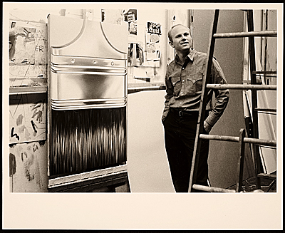 [James Rosenquist in his studio with Paint Brush]
