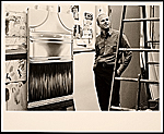 [James Rosenquist in his studio with Paint Brush ]