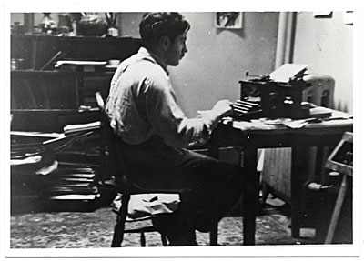 Jacob Kainen at a desk typing