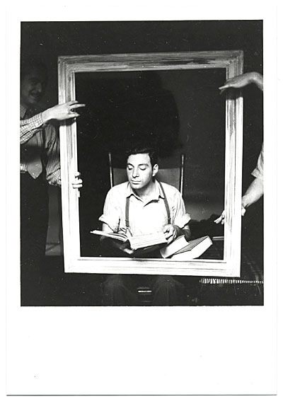 Jacob Kainen reading while sitting in a picture frame