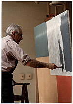 Jacob Kainen painting at an easel