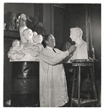 [Charles Keck working on a sculpture ]