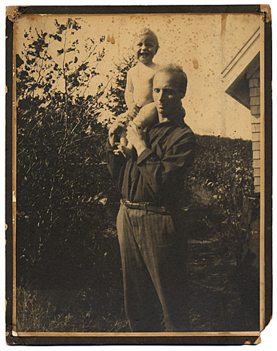 [Rockwell Kent outdoors with a young child]