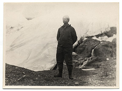 Rockwell Kent standing in front of a glacier