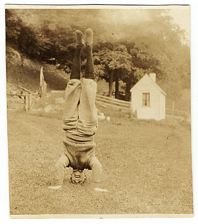 Rockwell Kent standing on his head
