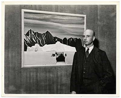 Rockwell Kent with one of his paintings
