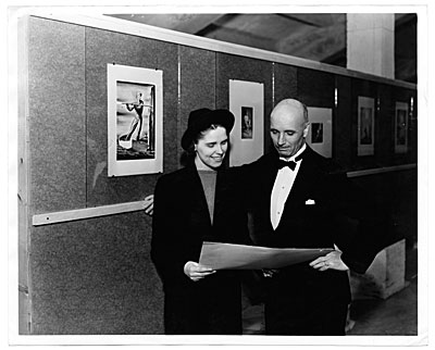 Rockwell Kent and an unidentified woman in a gallery