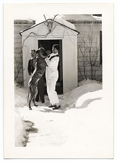 [Rockwell Kent playing in the snow with his dog]