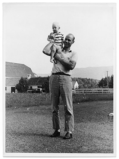 [Rockwell Kent with a small child on his shoulder]
