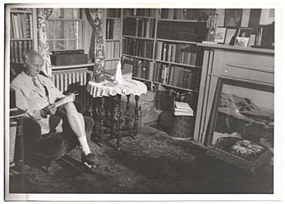 Rockwell Kent reading in his study