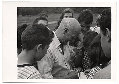 Rockwell Kent at a camp for teens signing autographs