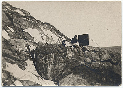 Rockwell Kent painting on a snowy ledge