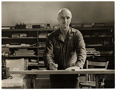 Rockwell Kent working at a drafting table