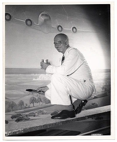 [Rockwell Kent working on an aviation themed mural]