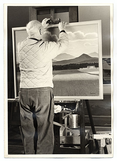 [Rockwell Kent with a landscape painting]