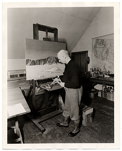 Rockwell Kent working on a painting