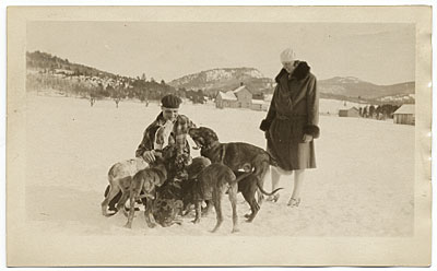 [The Kents with a group of dogs]