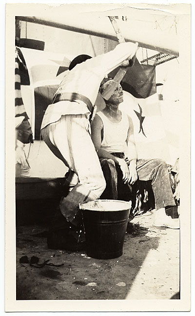 Rockwell Kent getting a shave