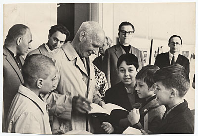 Rockwell Kent with a group of children while on a trip to the USSR
