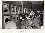 Rockwell Kent's work being viewed in a Russian art gallery