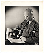 Rockwell Kent reading World Famous Paintings