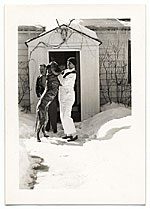 Rockwell Kent playing in the snow with his dog