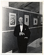Rockwell Kent in formal wear in a gallery