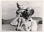 Rockwell Kent with a small child on his shoulder