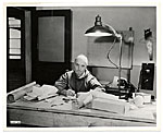 Rockwell Kent working at his desk