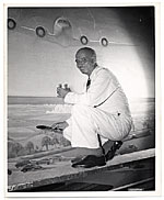 Rockwell Kent working on an aviation themed mural