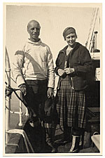Rockwell and Sally Kent standing a boat