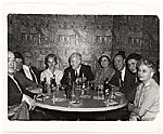 Rockwell Kent and others sitting around a table