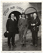 Rockwell Kent and two unidentified men with a Stout Air Lines plane