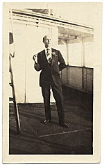 Rockwell Kent on deck in a formal suit