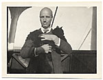Rockwell Kent holding the ships cat