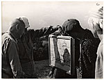 Rockwell Kent admiring a local artist during a trip to the USSR