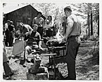 Attendees at a blacksmithing workshop