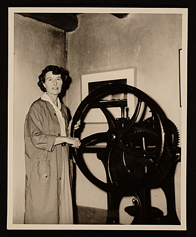 [Gene Kloss operating a printing press]