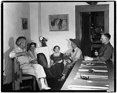 [John and Dolly Sloan and friends in the dining room at Sloan's Santa Fe Ranch]