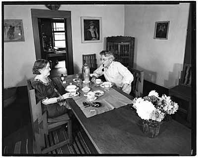 Dolly and John Sloan seated at the table in their Santa Fe home