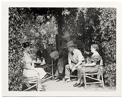 John Sloan and friends under a trellis at Sloans Santa Fe Ranch