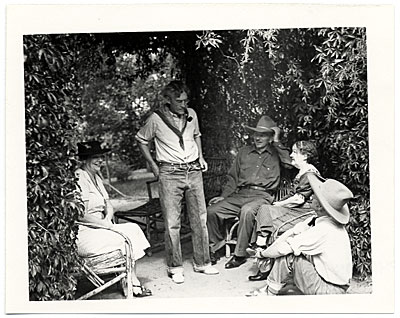 [Teresa Bakos, John Sloan, Jozef Bakos, Dolly Sloan and Will Shuster under a trellis at Sloan's Santa Fe Ranch]