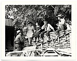 Dolly and John Sloan and friends sitting on a wall at the Sloans Santa Fe Ranch